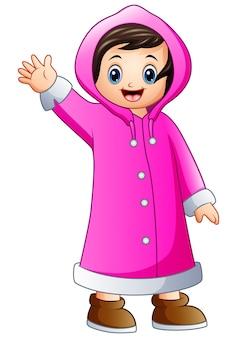 Menina dos desenhos animados na jaqueta de inverno rosa acenando