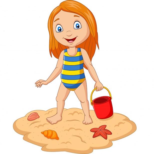 Menina dos desenhos animados segurando areia balde na praia tropical