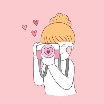 Menina e câmera bonitos do dia dos valentim dos desenhos animados.