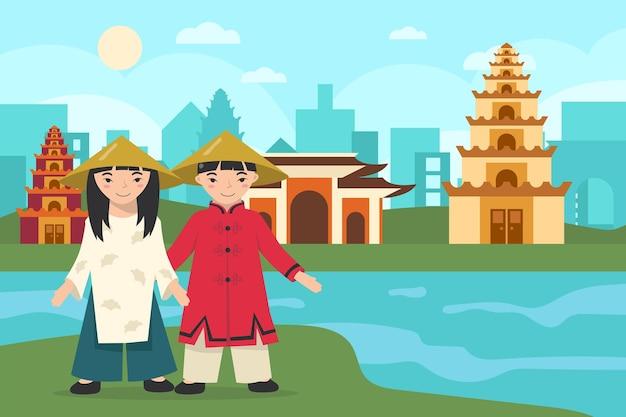 Menina e menino asiáticos usando chapéus e roupas tradicionais