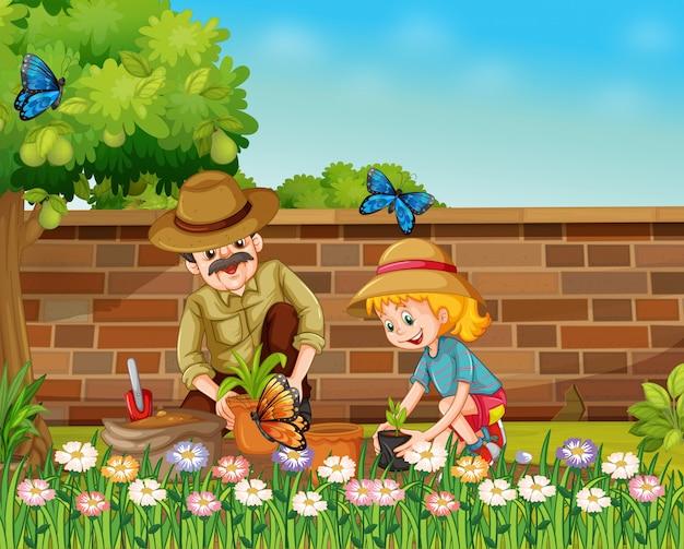 Menina e pai plantando árvores no jardim