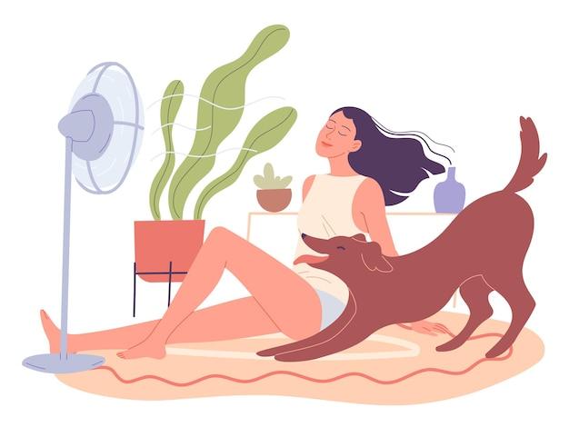 Menina e seu cachorro estão relaxando em casa pelo ventilador.
