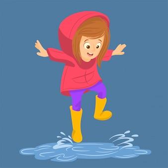 Menina em casaco impermeável salta na poça