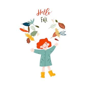 Menina está brincando com folhas de outono.