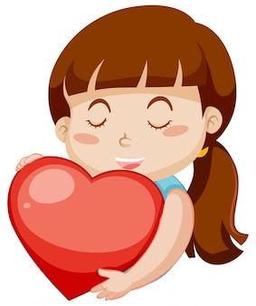 Menina feliz, abraçando o grande coração vermelho sobre fundo branco