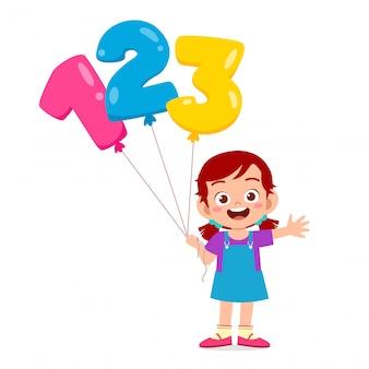 Menina feliz criança fofa segurando o texto do ballon