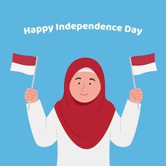 Menina feliz e fofa com hijab segurando a bandeira da indonésia comemore o dia da independência