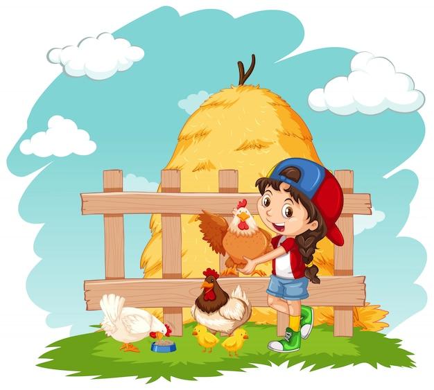 Menina feliz e galinhas na fazenda