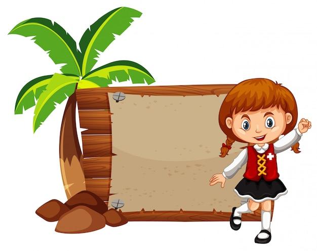 Menina feliz e placa de madeira