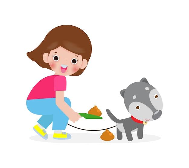 Menina feliz limpando o cachorro, o cachorro está fazendo cocô
