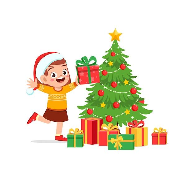 Menina feliz segurando um presente de natal