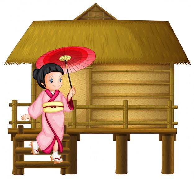 Menina japonesa na cabana de bambu Vetor Premium
