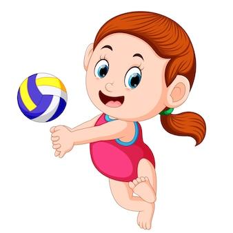 Menina joga a bola de vôlei