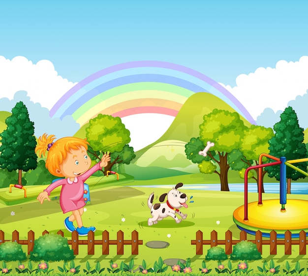 Menina jogando osso para cachorro no parque