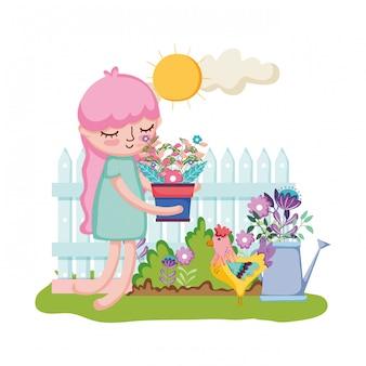 Menina levantando a planta de casa com vedação e aspersão