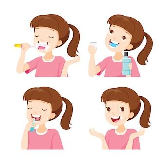 Menina limpando dentes, reduza o mau hálito e a cárie