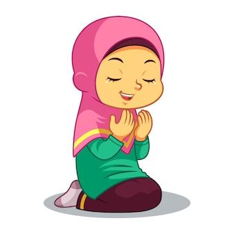 Menina muçulmana rezando