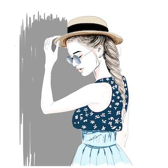 Menina no chapéu de palha