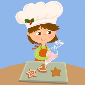 Menina no topo de um biscoito com creme usando um saco de confeitar