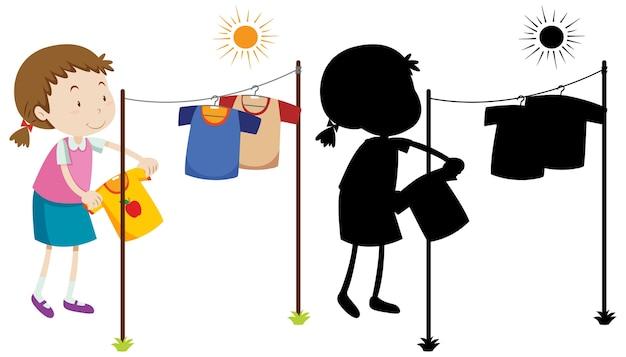 Menina pendurando camisa molhada para secar com sua silhueta
