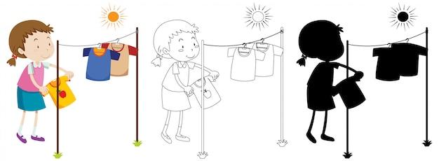 Menina pendurando roupas molhadas para secar com seu contorno e silhueta