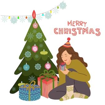 Menina prepara presentes perto de árvore de natal