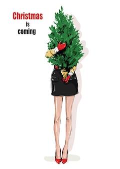 Menina segurando a árvore de ano novo