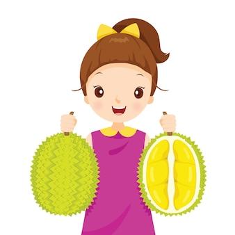 Menina segurando durian, frutas tropicais, rei das frutas tailandesas