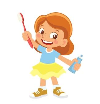 Menina segurando uma escova de dentes e pasta de dente
