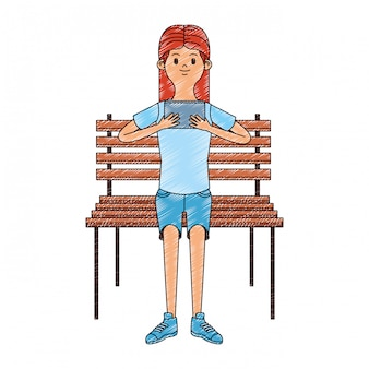 Menina sentada na cadeira usando o rabisco de videogame portátil