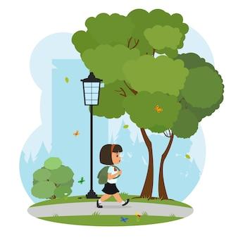 Menina vai para a escola com uma mochila.