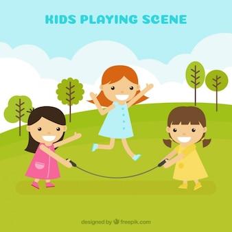 Meninas alegres que jogam com corda de salto ao ar livre