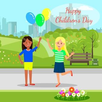 Meninas alegres segurando balões nas mãos no parque.