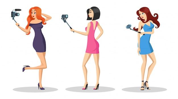 Meninas bonitas com cabelos compridos em pé e gravando vlog de moda, vídeo tutorial ao vivo.