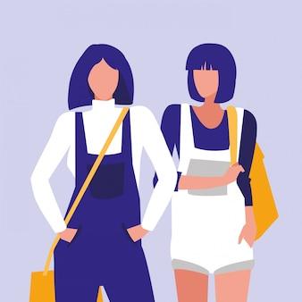 Meninas bonitas que modelam com bolsa