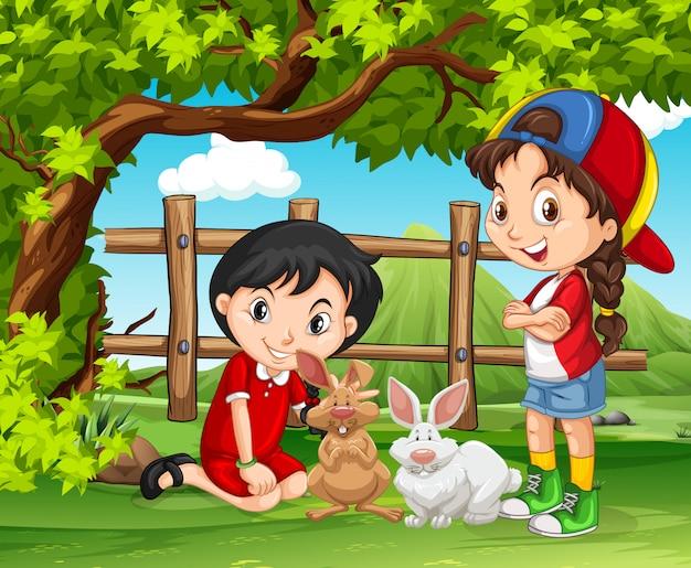 Meninas brincando com coelhos na fazenda