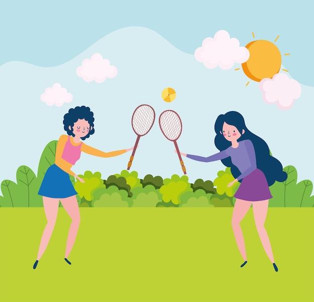 Meninas brincando com raquetes