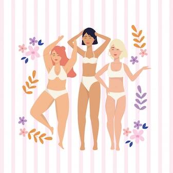 Meninas de beleza com roupas de baixo e ramos de plantas