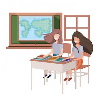 Meninas de estudante novas na sala de aula de geografia