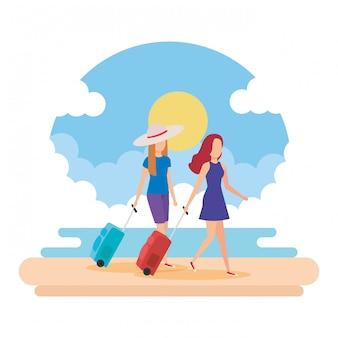 Meninas de turistas com malas na praia