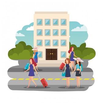 Meninas de turistas com malas na rua