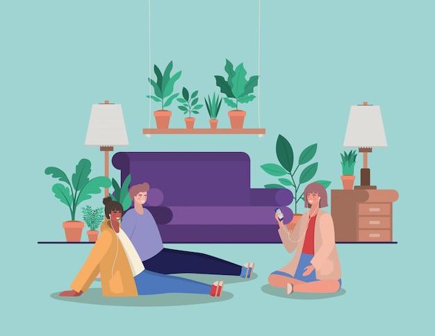 Meninas e menino com smartphones em casa