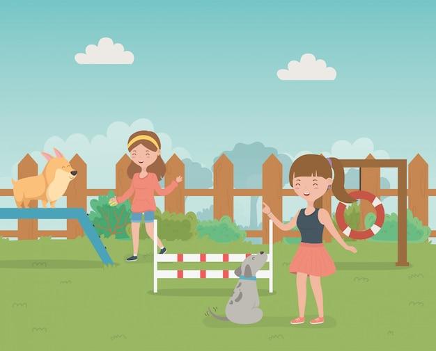Meninas jovens, com, cute, pequeno, cachorros, mascots, em, a, campo