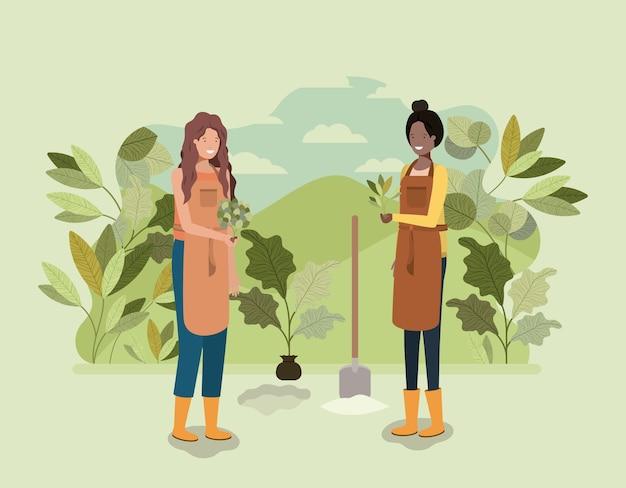 Meninas plantando árvores no parque