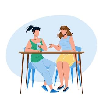 Meninas sentadas à mesa e conversando juntos vector. mulheres jovens bebem água e conversando, fofoca ou reunião de negócios. personagens senhoras amizade ou parceria ilustração flat cartoon