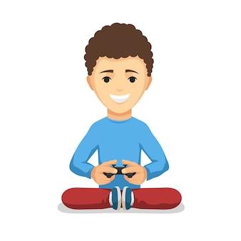 Menino adolescente encaracolado com gamepad do controlador de jogo isolado no fundo branco.
