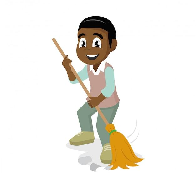 Menino africano com vassoura e lixo.