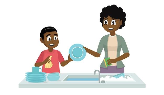 Menino africano lavando louça com a mãe