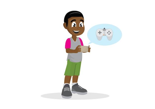 Menino africano que joga o jogo no smartphone.