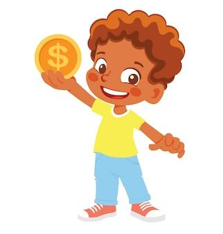 Menino afro-americano tem moeda. moeda de ouro na mão
